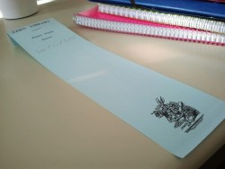 A bookmark of the CERN library. White rabbit included…