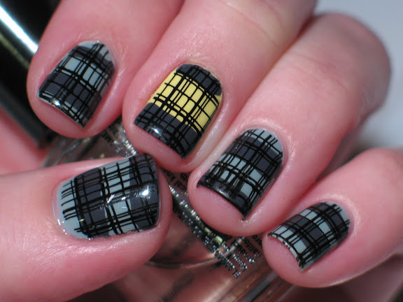 I think this was my bday mani if I remember correctly.  plaid is fun! and grey and yellow is one of my fav color combos.