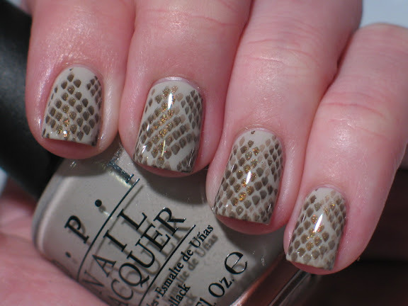 Snake print notd image from new bundle monster 25pc set, opi skull & glossbones base, stamped with ChG Wagon trail and Ingrid. so pretty!