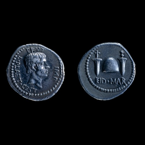 fvckyeahromanhistory:  Ides of March Special: Silver Denarius of Marcus Brutus, Macedonia, 43-42 BCE This coin was struck in honour of Marcus Junius Brutus, one of the assassins of Julius Caesar. The reverse shows the cap of liberty given to freed slaves flanked by two daggers. This indicates Brutus' intention of freeing Rome from Caesar's imperial ambitions and the murder weapons employed to do so. Below is the day of the deed; EID.MAR, the ides of March. Few coins capture a moment in history with such stark and brutal imagery. Brutus had carried out the attack with some fellow Roman Senators in 44 BC when Caesar had come unarmed to address the Senate on 15 March. This day was known to the Romans as the ides, or the middle day of the month and was recognised on a new calendar system that Caesar himself had established just two years before. The assassins, or 'freedom party' as they regarded themselves, fled Rome to Macedonia to raise an army. However, they were defeated by Caesar's allies led by Mark Antony and Octavian at the Battle of Philippi (42 BC). Brutus subsequently committed suicide. The decision to flee east was probably influenced by the richness of the provinces of the eastern Roman Empire - raising an army was a very costly business. Supplies needed to be bought and soldiers needed wages. Amongst the coins the conspirators briefly struck to this end was this, the 'Ides of March' denarius. P. Matyszak, Chronicle of the Roman Republi (London, Thames & Hudson Ltd, 2005) M.H. Crawford, Roman republican coinage (Cambridge University Press, 1974)