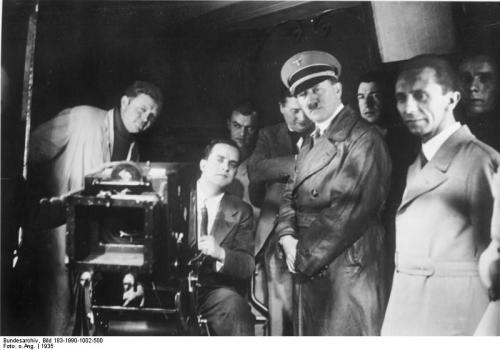 Adolf Hitler and Joseph Goebbels on a visit to the UFA studios in January 1935. On the left, film producer Günther Stapenhorst.