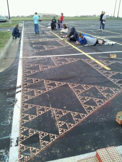world-shaker:  Students at Eudora High School create a Sierpinski Triangle in their parking lot. Out of pennies. Full album here.