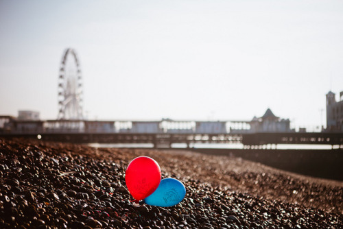 Two abandoned balloons on Brighton beach  I shot this Instagram to check it out here. When I take what I think is a interesting photograph with Instagram I always want to shot it properly, weather that be on film or on a 5D. I am lomokev on Instagram to by the way.