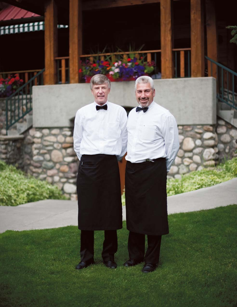 James Robson and Yves Drouin, servers at the Post Hotel in Lake Louise, get ready for another busy shift. 