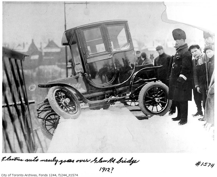 1912, first electric car accident at Glen Road Bridge (Toronto, ON) Henry Pellatt who built Casa Loma was the firs owner of electric car in Toronto. When he ordered one and got it delivered, he was so excited to shof off it in society that went to the city immediatly without reading the manual. It appeared though that breaking interface wasn't that obvious and magnate wasn't able to stop it, keeping riding circles and waving people who came to see it pretending it's all right. (via Casa Loma | Anton Bielousov)