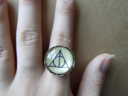 Adjustable Deathly Hallows ring, for sale in my etsy shop :) or if you don't have an etsy account & would like to buy one, message me through the ask page & we can sort something out with Paypal All orders come with a tiny clay totoro (while stocks last, then i'll make something different!)
