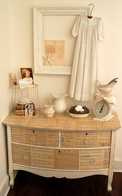 I love the sheet music decoupage on that dresser!