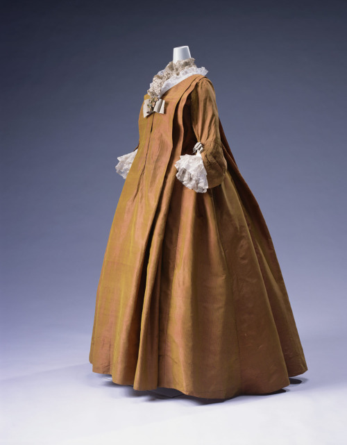 The early 18th century arrival of the loose-fitting robe volante into mainstream formal fashion (it had previously been worn only as very informal wear or negligee) must have been a boon to women seeking fashionable maternity wear. This gorgeous extant example is from the Kyoto Costume Institute and dates to circa 1720.