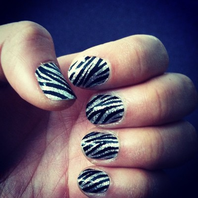 I didn't know #zebras came in glitter! #ohwell #manicure #nails (Taken with Instagram at Karmaloop HQ)