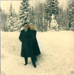 My parents, hugging in the snow.