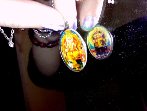 got this little charm off ebay, it's double sided (two hindu deities for the price of one) and I love it