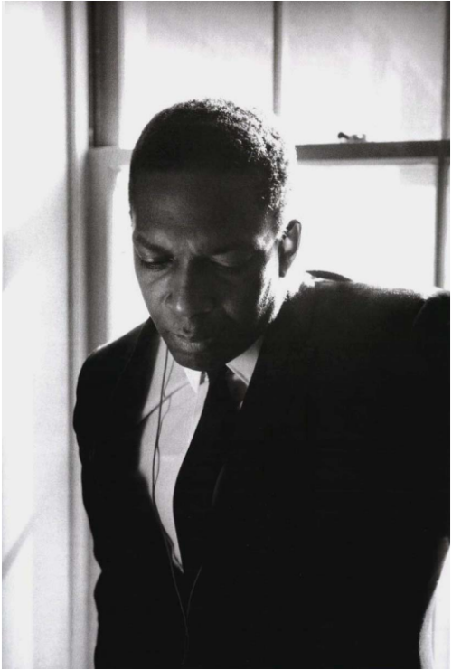 John Coltrane backstage at Stanford University a few months before his death in 1966 (photo by Jim Marshall)
