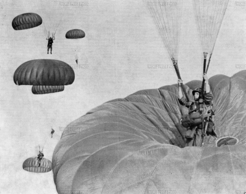 A parachutist lands on top of another, both jumpers made it to the ground safely.  Year: 1962 Photographer: Dozier Mobley
