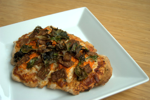 "BBQ Tempeh Pizza Who says vegan can't be delicious? Piled a base of hearty pizza sauce over whole wheat crust, I swear upon the stars- it's all homemade! A gratuitous serving of three cheeses follow, pseudo (soy) cheese of course, let's get our fake cheese on- ""Monterey Jack"", ""Cheddar"", and Daiya ""Mozzarella"". Instead of hideous pepperoni, barbeque marinated tempeh comes to the rescue! We need a serving of greens to make it a balanced meal, so throw on some spinach and field greens to color the palette. Dash olive oil on the greens to ensure absolute crunchiness! Believe it or not, this is my first time making pizza from scratch. Check out my blog: http://keepfitgoing.tumblr.com for more sexy recipes ;) [Looks to Daiya for! Thanks for sharing, keepfitgoing! (Also, nice tip re: the olive oil on the greens. Imma try that some time.) - ed.]"