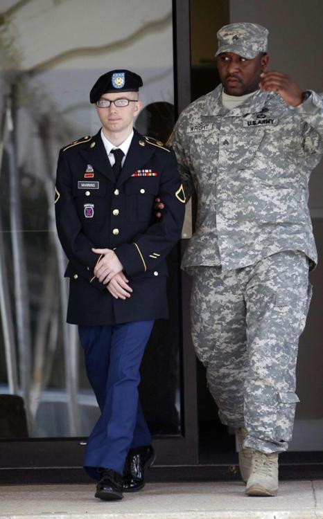"kateoplis:  nickturse:  Army Pfc. Bradley Manning (L) leaves the courthouse after his motion hearing at Fort Meade, Maryland March 15, 2012. Manning, a U.S. Army intelligence analyst accused of the largest leak of classified documents in U.S. history, deferred pleading guilty or not guilty in a military court arraignment on Thursday, marking the first step in a court martial that could land him imprisonment for life. Reuters  ""The United Nations official investigating the American military's treatment of Bradley Manning has ruled that the US government imposed cruel, inhuman, degrading and borderline torturous treatment on the alleged WikiLeaks contributor…  In a just-published addendum on international torture issues submitted to the UN's Human Rights Council, Mendez writes that his investigation into America's detainment of Manning leads him to believe that the US is at fault for imposing cruel and inhumane treatment on the soldier. The rapporteur explicitly calls out the United States for holding Manning in solitary confinement for 23-hours a day for a period of nearly a year, all the while neglecting to formally file charges against the soldier."" (via)"