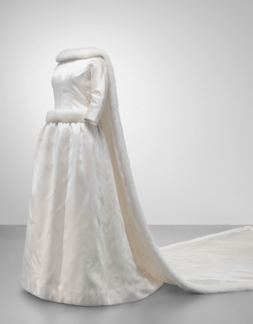 Wedding dress worn by Queen Fabiola of Belgium, 1960 Paris (worn in Brussels), Mona Bismarck Foundation She was married to Baudouin on December 15, 1960.  The dress is made of satin and mink.