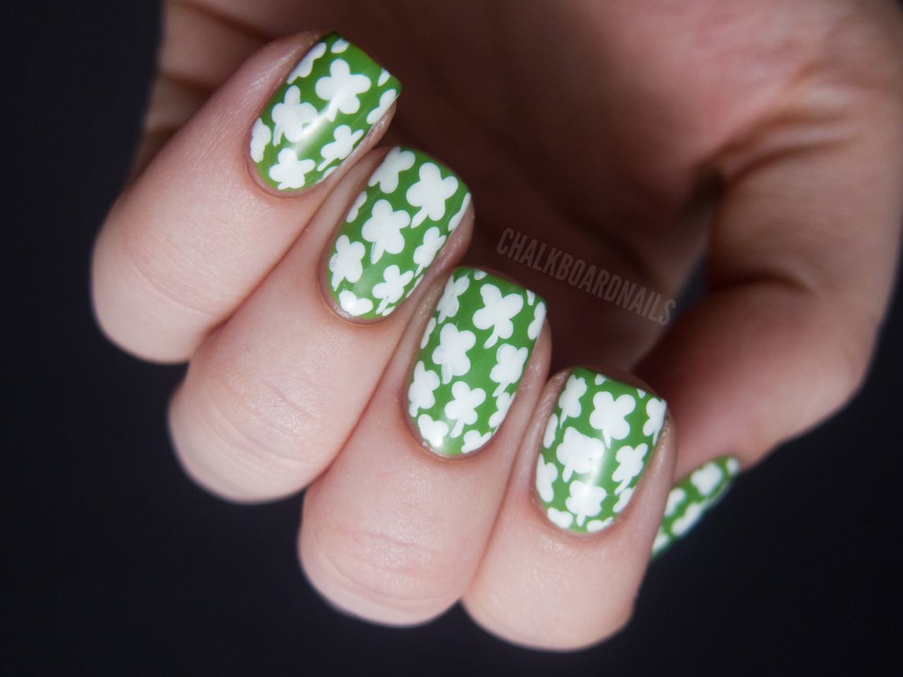 So, so lucky! Orly FreshWhite shamrocks freehanded on with a dotting tool and small nail art brush