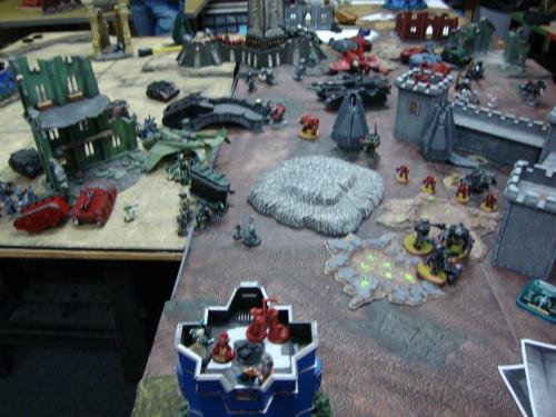 Ghazkgull and the Furioso Librarian are going man to man! The Kanz have ganged up on the four Blood Angels! Ezekiel's tactical squad is locked in with some Ork Boyz, who are now contesting the objective. The berzerkers took out a razorback and the Blood Angels inside, not to mention the Warboss has moved into contention, assaulting Azrael and his Command Squad. Oh geez, things aren't going well here.