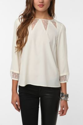 Kind of obsessing over this ivory blouse from Urban Outfitters.