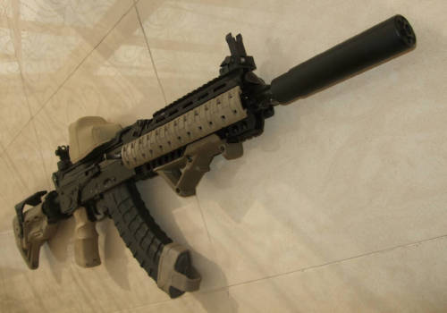 gunrunnerhell:  Heavily customized AK-47… (Normally I'm a purist when it comes to Russian weapons but this one isn't too bad. The owner did improve the sight radius by having a further back rear sight.)