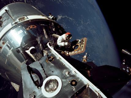 "This image, taken on March 6, 1969, shows the Apollo 9 Command and Service Modules docked with the Lunar Module. Apollo 9 astronaut Dave Scott stands in the open hatch of the Command Module, nicknamed ""Gumdrop,"" docked to the Lunar Module ""Spider"" in Earth orbit. His crewmate Rusty Schweickart, lunar module pilot, took this photograph from the porch of the lunar module. Inside the lunar module was Apollo 9 commander Jim McDivitt. The crew tested the orbital rendezvous and docking procedures that made the lunar landings possible.Image Credit: NASA"