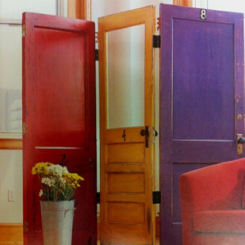 DIY Door Room Divider. No tutorial but you can use recycled doors from a salvage yard and piano hinges (hinges that bend both ways) to connect the doors. I normally don't post Pinterest as a source, but I can't find this photo anywhere else. Uploaded to Pinterest by Jessica Canale here.