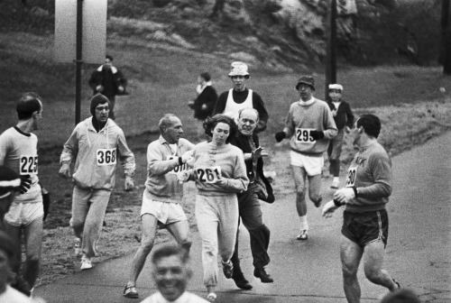 "kateoplis:  ""In 1967, Kathrine Switzer was the first woman to run the Boston marathon. After realizing that a woman was running, race organizer Jock Semple went after Switzer shouting, ""Get the hell out of my race and give me those numbers."" However, Switzer's boyfriend and other male runners provided a protective shield during the entire marathon.The photographs taken of the incident made world headlines, and Kathrine later won the NYC marathon with a time of 3:07:29."" Wiki"