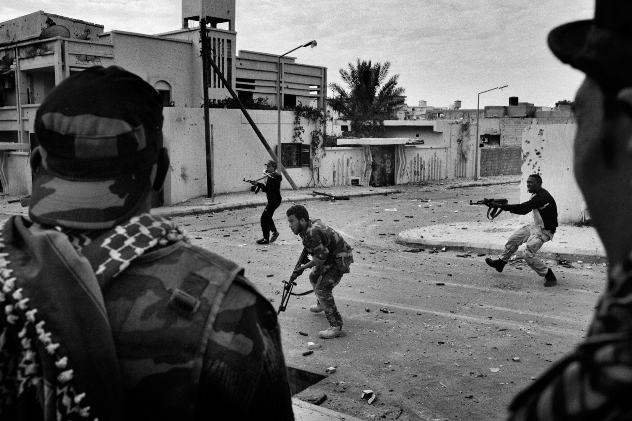 Mauricio Lima—New York Times Anti-Gaddafi fighters from Benghazi engage on a firefight with snipers loyalists to Col. Muammar el-Gaddafi during a street battle inside Gaddafi's hometown city of Sirte, Libya, on Oct. 19, 2011. An exhibit of photographs from Libya by Mauricio Lima—his first solo show in Brazil—is open at the Tiradentes Photo Festival through March 18. More info here (in Portuguese).