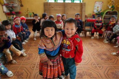 Viet Nam, 2009: Hmong children attend a UNICEF-supported school in the remote Lao Cai Province. The school teaches classes in Vietnamese and the local Hmong dialect, part of a Government initiative to improve bilingual education for minority children. Ethnic minorities have high drop-out rates due to a lack of bilingual teachers and curricula; the Government, UNICEF and partners are working to reverse this trend. © UNICEF/Josh Estey To learn more about UNICEF's work, please visit: http://www.unicef.org/
