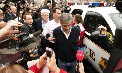 washingtonpoststyle:  George Clooney is arrested this morning after protesting at the Sudan Embassy in Washington, D.C. Live updates here. Photo by Kevin Lamarque (Reuters)