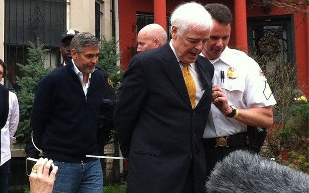 "George Clooney Arrested During Protest at Sudanese Embassy in Washington  George Clooney, his father, Nick Clooney and several protesters have been arrested for protesting at the Sudanese embassy in Washington, D.C. According to the Washington Post, his arrest wasn't exactly unplanned.  Clooney, according to the AP, said Friday that he hoped to draw more attention to the issue of Sudan's President Omar al-Bashir blocking food and aid to areas of near the border of South Sudan. The Washington Post explained this morning: ""By standing on the embassy's private property, they're likely to get cuffed, arrested and charged."" The Washington Post's Aaron Leiko and James Buck described the scene of the arrest which occurred around 11 a.m.:   Clooney and the group of protesters stepped onto embassy grounds after giving short speeches, at which point they were instructed that they must leave or be arrested. On the third warning, officers told the group they were under arrest, and the protestors lined up to get handcuffed and were removed to a waiting van.  Read more. [Image: Selma Talha Jebril]"