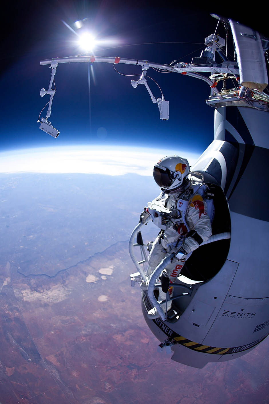 Felix Baumgartner on track for highest ever free-fall jumpStunt co-ordinator, skydiver, helicopter pilot and B.A.S.E. jumper Felix Baumgartner is on track to break four world records by jumping out of a balloon 36.5 kilometres above the earth.Austrian Baumgartner conducted the first manned test flight for Red Bull Stratos on Thursday in Roswell, New Mexico. In this test he reach the altitude 21,800 meters (71,500 ft) and landed safely near Roswell.Red Bull Stratos is a mission to the edge of the earths atmosphere, where upon reaching altitude of 36,000 meters (120,000 ft) by helium balloon, the 41-year-old hopes to complete the highest-ever freefall jump made by a human by plunging out of a specially designed balloon in the stratosphere.Daredevil Baumgartner will also attempt to break the speed of sound in the free-fall to the ground. (Photo: Jay Nemeth/Red Bull via Getty Images)