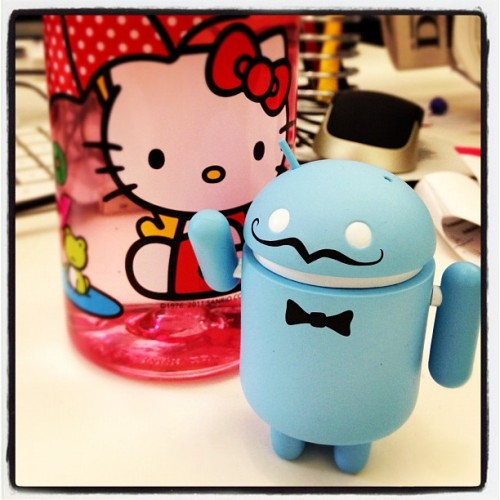 New robot friend hangin' with Hello Kitty on my desk. (Taken with instagram)
