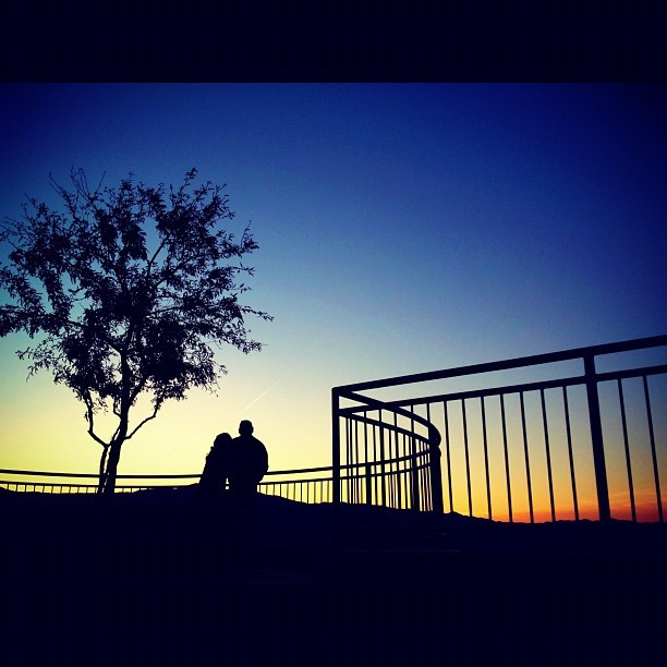 two lovers admiring an Arizona sunset (Taken with Instagram at Sunset Point Rest Stop)
