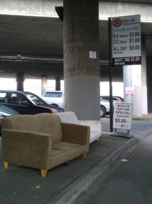 Photography Of Dres Mera-Couches in the parking lot in Chinatown-ID
