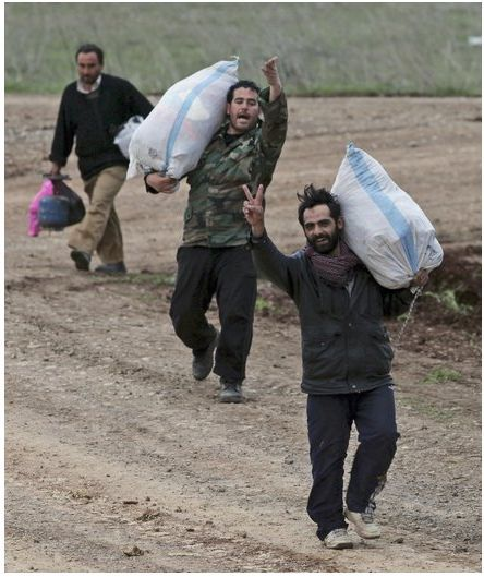 "Bag's Take-Away:  The only photos of happy Syrians are those of them escaping to Turkey. via The Charlotte Observer (photo credit: Burhan Ozbilici/AP Photo caption:  A group of Syrians fleeing violence in their country, walk towards the Turkish border near Reyhanli, Turkey, Thursday, March 15, 2012. Turkey said Thursday it was considering the establishment of a ""buffer zone"" along its border with Syria after more than 1,000 Syrians crossed into Turkish territory in the latest influx of refugees escaping attacks by security forces in their homeland.) Visit BagNewsNotes: Today's Media Images Analyzed ————— Topping LIFE.com's 2011 list of Best Photo Blogs, follow us at: BagNewsNotes; BAG Twitter; BAG Facebook; Bag by Email."