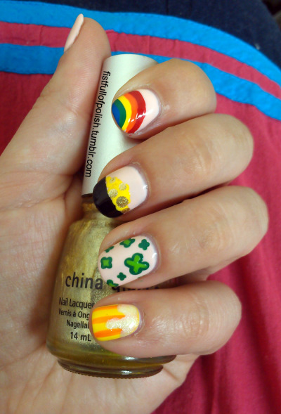 fistfullofpolish:  Happy St. Patrick's Day!  I whipped up a quick St. Pat's manicure so my clients don't try to pinch me. :)  There's a rainbow, pot of gold, two-tone shamrocks and a somewhat unsuccessful beer mug.  Still pretty festive!