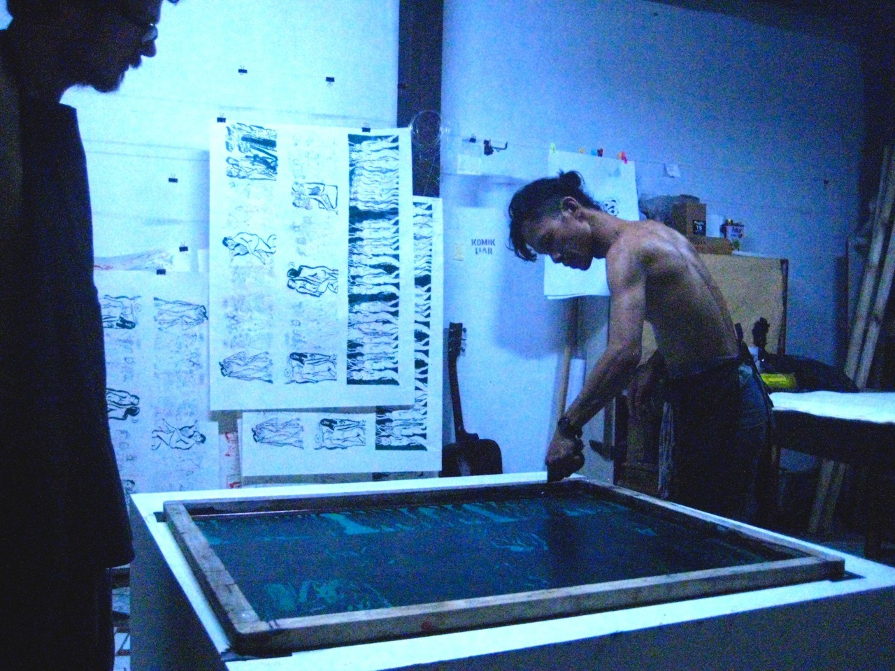"The printing of ""Rahasia Purbakala dari Tenaga Kekal"" (Ancient Secrets of Eternal Energy), a six panel fold out book, silkscreened by hand and published October 2011 at Joglo Jago Studios in Yogyakarta Indonesia by Arrington de Dionyso assisted by Rudy Atj. Copies available in the US from www.arringtondedionyso.etsy.com"