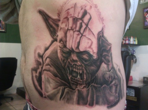 Awesome tattoo artist makes awesome tattoos.Posted at HFZ - http://hopeforzombies.com/zombie-yoda-tattoo/