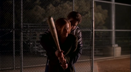 """That's it, Scully, feel the weight of it in your hand. Whoa, easy now, don't grip it too tight. Yeah, nice and gentle."""