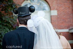 disneyweddinginspiration:  A perfect Disney Details moment caught on camera. This couple's Disney accessory of choice? Embroidered Disney wedding hats! A Mickey Mouse top hat for the Disney groom and the bride, a veiled pair of Minnie ears!  At home Disney Inspiration (Drew and Mary-Beth)