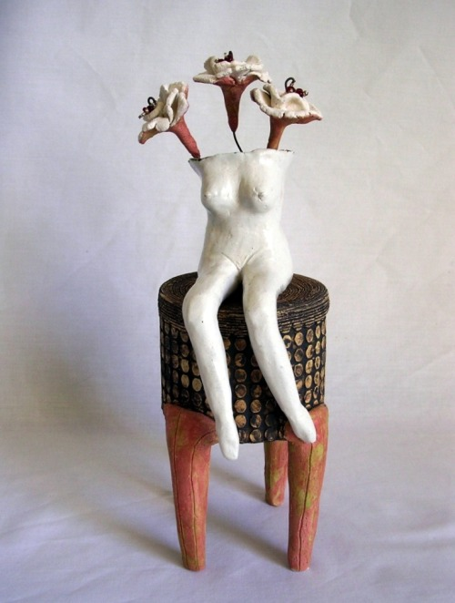 Liliana Folta: Sitting Pretty, 2008, ceramic, oxides, glazes, crystal beads, high temp wire, 10.5x3.5x3.5in.