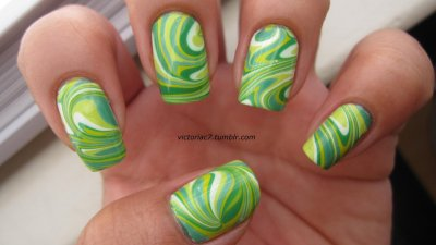 St. Patty's Day water marble! Colors used: Essie - Pretty Edgy OPI - Gargantuan Green Grape, Jade Is The New Black, Who The Shrek Are You? Sally Hansen X-treme Wear - Green With Envy