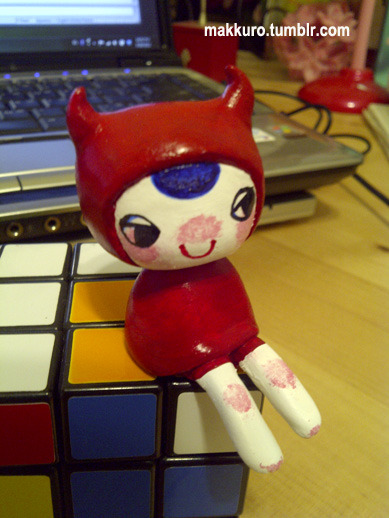 paper mache akumazukin-chan figure colored with acrylic paint. i think she still needs a top coat of some sort so i shall consult the google to figure that out. moving on to finish paper mache kabihime!