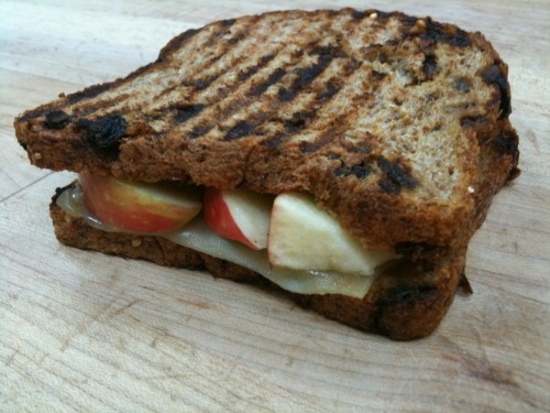 nutritiousnomz:  Cinnamon Raisin Cheesy Apple Sandwich. If you have a panini press, make this now! If you don't, then cook this baby up in a pan with a little bit of earth balance.  Ingredients 2 Slices Cinnamon Raisin Ezekiel Bread 1 Slice Mozzarella Cheese 1/2 Sliced Honeycrisp Apple