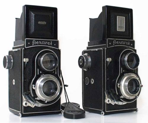 My history of Czech TLRs part 8: the Flexaret IV and IVa (This series of posts about Flexarets and their precursors are based solely on my experience with the cameras and are not meant to be in any way historically accurate.) The IV and IVa are an evolutionary step in the Flexaret lineage. They see a return to knob wind: much more reliable than the flakey crank of the III/IIIa; but also have several advances. The red window is gone and the frame counter (introduced on the III but I still recommend the red window with one of those beasties) actually works well enough to rely on it - the first working autostop on a Czech TLR since the pre-WWII Bradac Autoflex. The wind is not coupled to the shutter advance so there is still a need to go fumbling around the taking lens to find a shutter cock lever. There is, however double exposure prevention. Resetting the shutter after taking a photograph will not allow a second exposure until the film has been wound; not even using a cable release in the body release. There is a tiny release tab on the shutter, so multiple exposure is possible if one is really keen.  The release has been moved from the shutter itself to a lever on the camera front. It is an odd release but I really like it, and there is, as mentioned, a hole in the front to which a standard cable release may be fitted. Earlier Flexarets had the cable release connection as part of the shutter (except my III - it seems the Compur Rapid has no remote release at all). The final finesse over the earlier Flexarets is the finder hood which is a well constructed two part folding hood folder instead of the four sloppy flaps used previously. The large magnifier was moved to the back of the hood and is much easier to flip up and down than earlier ones.  Loading is not as automatic as the older Rolleiflex automats but is straight forward. The holder for the film spool folds out on one side which makes fitting the fat plastic modern spools a little easier. Then align the wide arrow on the film backing paper to the small markers on the sides of the film gate and then shut the back. These markers are usually black dots but I have seen some red ones. The IVa can be used with 35mm film by using an adapter. The most obvious cosmetic difference between the IV and the IVa being the cut out 2x3 window in the finder cover which can be used as a 35mm frame guide/'sports' finder. It has a second counter on the side: one has to manually set it after each 12 exposures to get the next 12 up to 36. This is a pain and is the same mechanism used right through to the VII. The IVa is not useful as a 35mm shooter though as it has no means to rewind the exposed film. I have used 35mm with my Va and VI just to see how the adapters work but do not recommend it. I see no point in using 35mm in a medium format TLR when one can pick up a Spotmatic and fast 85mm lens for very little and have a far superior 35mm experience. Whilst neither camera will ever win a beauty contest I think the IV an IVa are functional and usable TLRs. They are reasonably easy to find and usually cheap. Probably only the IIa costing less, and the IV is a better camera than the IIa in almost all respects. Both my IV and IVa have Metax shutter and both seem to just keep on working. My IV has a rather lovely black bakelite lens cap. The IVa having the much more common translucent (and usually discoloured) plastic-y thing.