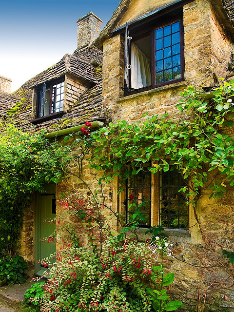 A Cottage in Arlington Row at Bibury, Gloucestershire by Anguskirk on Flickr.
