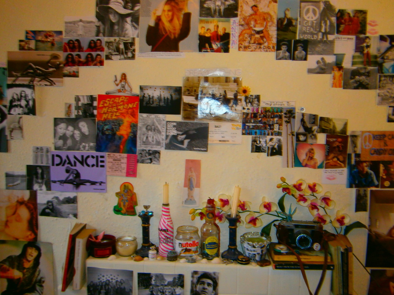 """This is my current bedroom (I'm a teenager now) in London. My walls are covered in EVERYTHING: photos, tickets, things cut out of magazines etc. This wall has just been redone (I get bored about three times a year and rip everything off my walls) and it is my current favorite.""—Monkeybiscuits This is beautiful! I love it.xoxo"