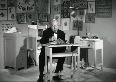 Pictured above: Sir Alfred Hitchcock, tattooing a slab of meat with his trusty cattle prod.