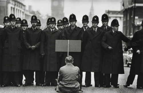 Don McCullin, A lone anti-war protester confronts police in Whitehall during the Cuban Missile Crisis, London, 1962.